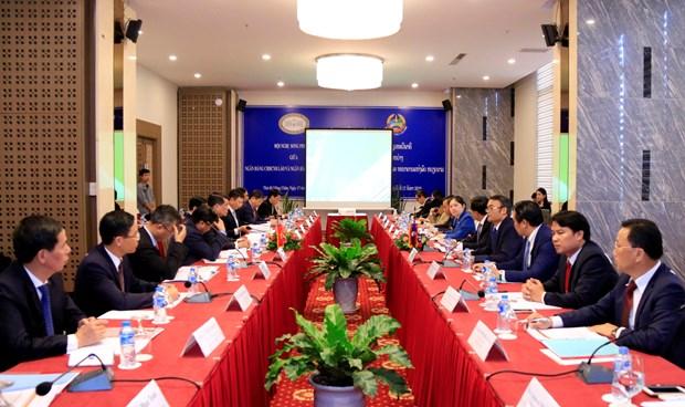 越南国家银行与老挝中央银行加强合作 hinh anh 1