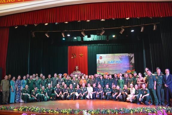 越南志愿军出色完成援柬国际任务30周年纪念活动在河内举行 hinh anh 1