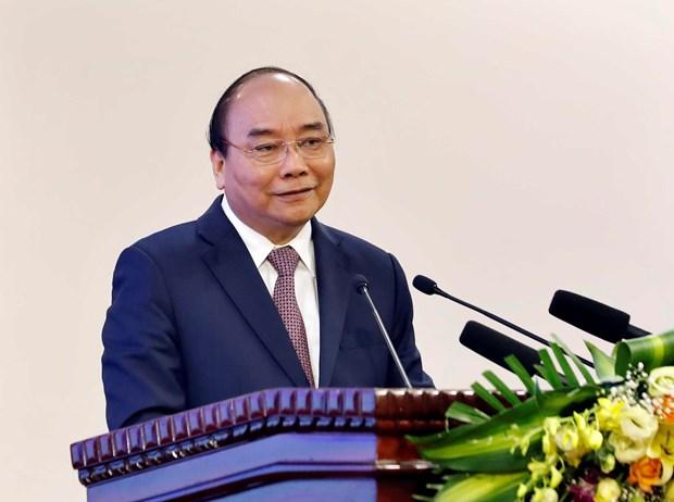 政府总理阮春福出席庆祝越南少年军校建校70周年见面会 hinh anh 1