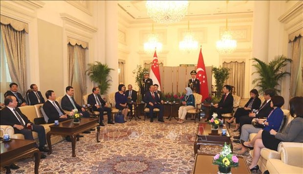 越南政府常务副总理张和平对新加坡进行正式访问 hinh anh 1