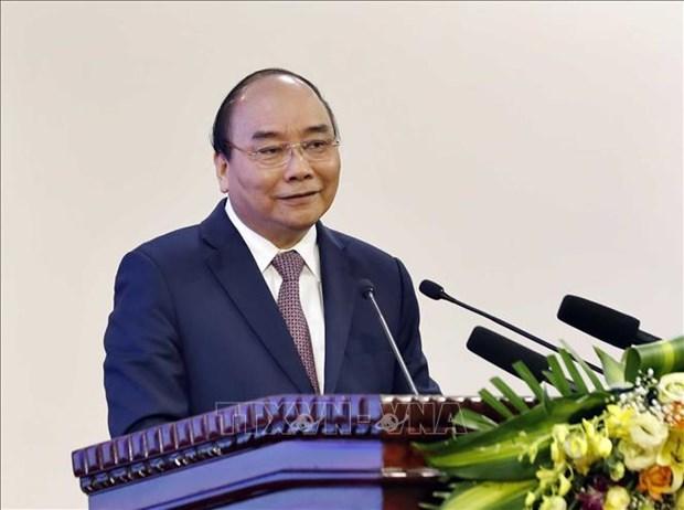 阮春福总理主持召开越南与老挝和柬埔寨合作项目评估会议 hinh anh 1