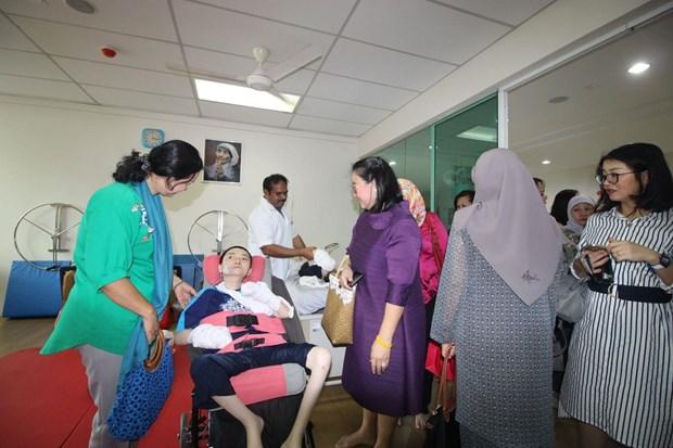 在马来西亚东盟妇女俱乐部大力开展慈善活动 hinh anh 1
