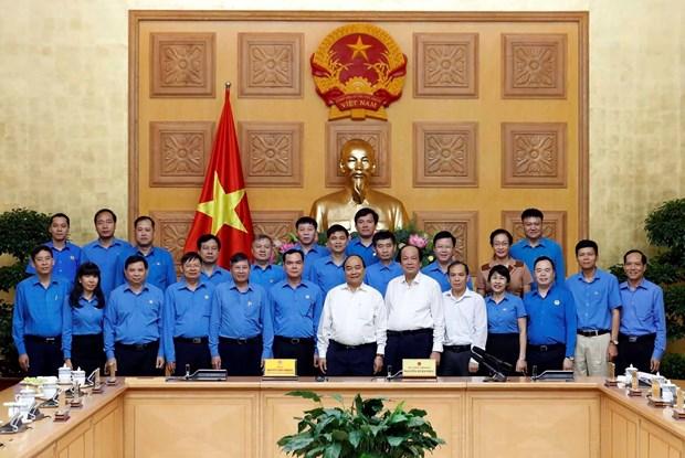 阮春福出席政府与劳动总联合会协调工作会议 hinh anh 2