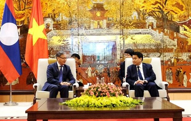河内市努力扩大与老挝各地方的合作关系 hinh anh 1