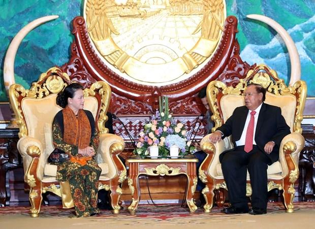 越南国会主席阮氏金银会见老挝人民革命党中央总书记、国家主席本扬 hinh anh 1