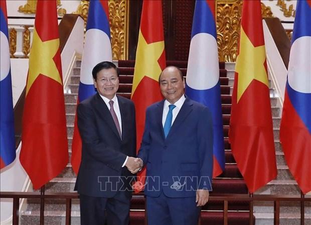 越南与老挝发表联合声明 hinh anh 1
