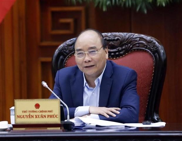 越南政府总理阮春福主持召开越共十三大经济社会常设小组会议 hinh anh 2