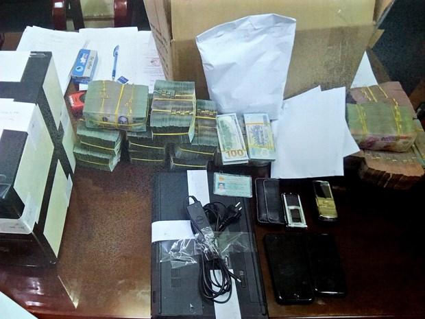 越南警方破获一起网络赌博大案 涉案赌资近3万亿越盾 hinh anh 2