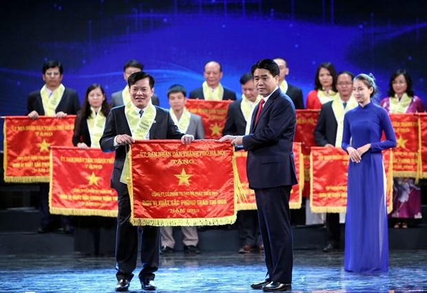 河内首都解放65周年:近200家企业受表彰 hinh anh 1