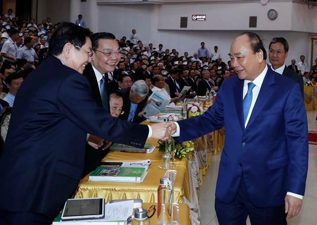 越南政府总理阮春福:越南新农村建设国家目标计划创造了历史性突破口 hinh anh 2
