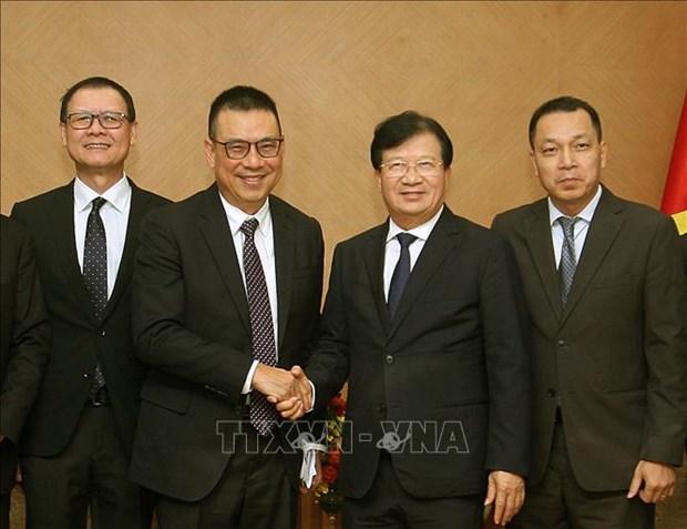 越南政府副总理郑廷勇会见泰国暹罗水泥集团总裁 hinh anh 1