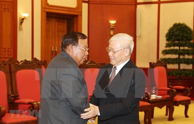 越共中央总书记、国家主席阮富仲会见老挝人民革命党总书记、国家主席本扬 hinh anh 1