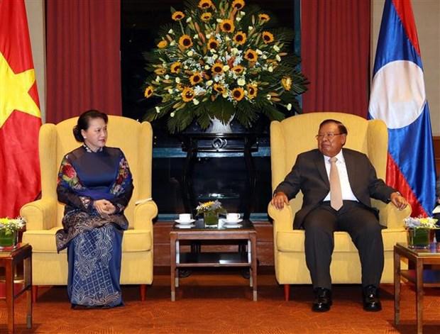 越南国会主席阮氏金银会见老挝人民革命党总书记、国家主席本扬 hinh anh 1