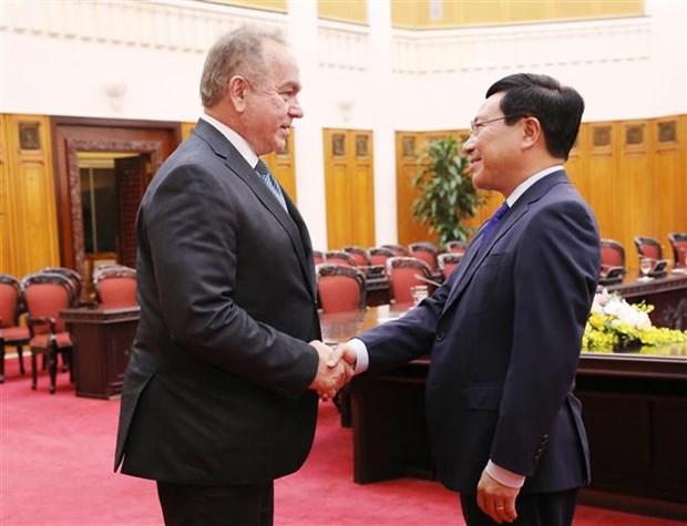 越南政府副总理范平明会见美国企业代表团 hinh anh 1