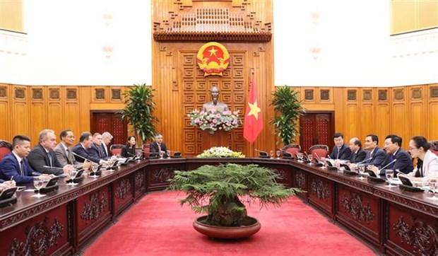越南政府副总理范平明会见美国企业代表团 hinh anh 2