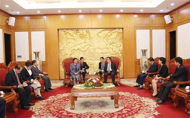 越共中央对外部部长黄平君会见老挝革命人民党中央对外部代表团 hinh anh 2