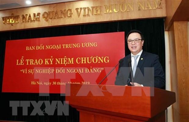 继承辉煌传统 提升越南共产党的对外工作质效 hinh anh 1
