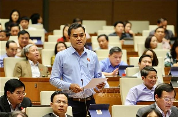 越南第十四届国会第八次会议:政府总理阮春福回答国会代表的询问 hinh anh 2