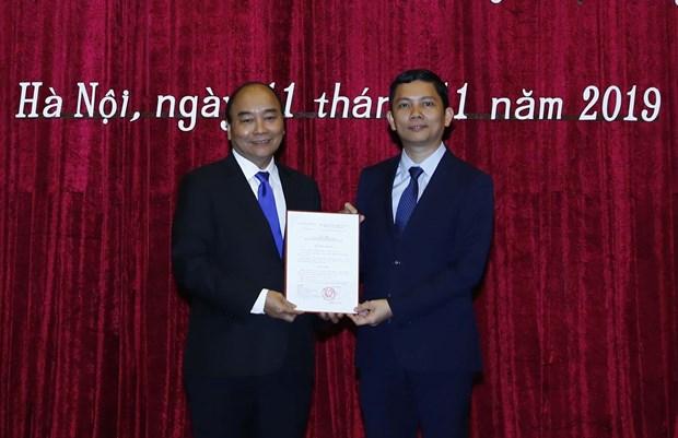 越南政府总理阮春福任命裴日光为越南社会科学翰林院院长 hinh anh 1