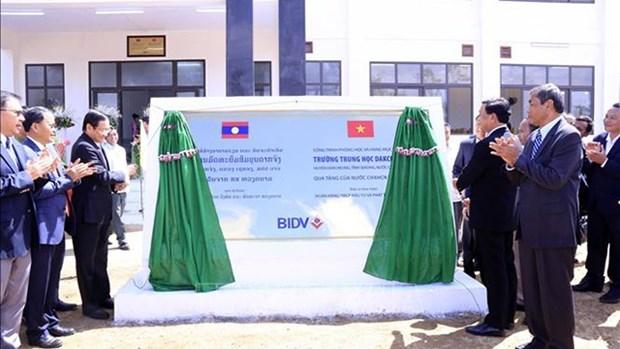 越南援建老挝色空省多征高中学校竣工移交 hinh anh 1