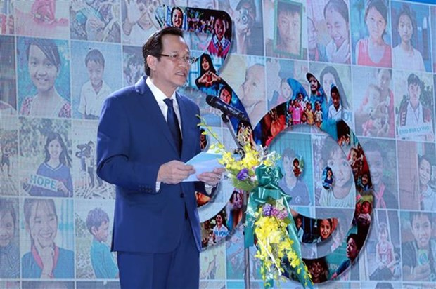 联合国《儿童权利公约》颁布30周年纪念典礼在河内举行 hinh anh 1