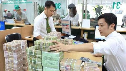 多家银行降低贷款利息 帮助企业解决困难、助力发展 hinh anh 2