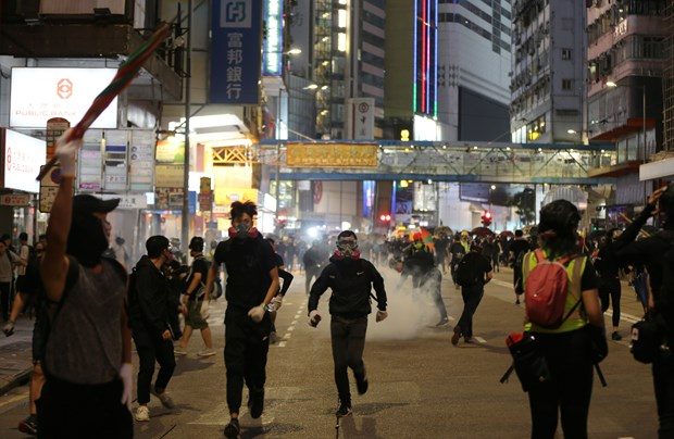 越南外交部:尚未收到有关越南大学生、公民在中国香港遭受损害的信息 hinh anh 1