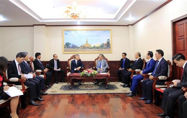 越南驻老挝大使馆庆祝老挝国庆44周年 hinh anh 1