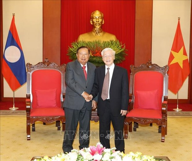 越南领导人致电祝贺老挝国庆44周年 hinh anh 1