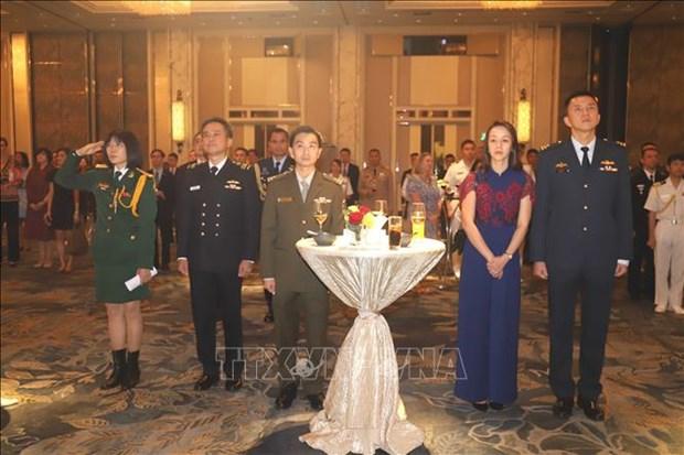 越南人民军建军75周年纪念活动在新加坡举行 hinh anh 1