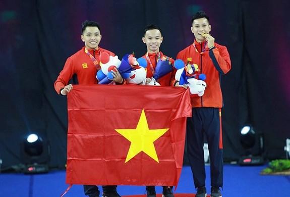 第30届东运会:越南体育代表团以80枚金牌名列奖牌榜第三位 hinh anh 1