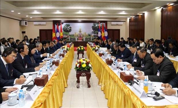 张和平副总理访问老挝 与老挝副总理会谈 hinh anh 2
