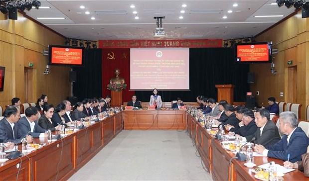 越共中央民运部部长张氏梅会见老挝建国阵线中央委员会代表团 hinh anh 1