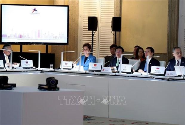 越南为第十四届亚欧外长会议作出突出贡献 hinh anh 2