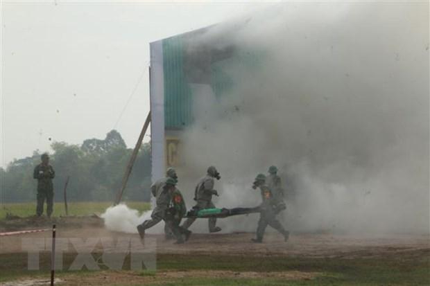 越柬两国国防部联合开展陆地边界地区搜救演习 hinh anh 1