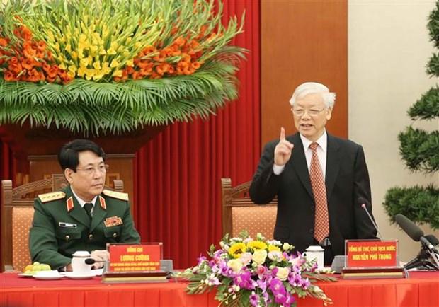 越南人民军建军75周年:国家主席阮富仲亲切会见在建设强大的全民国防体系中的先进模范代表 hinh anh 2