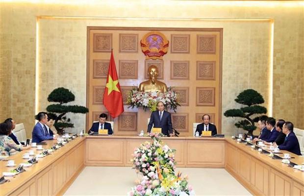 越南政府总理阮春福会见红星奖获奖青年企业代表 hinh anh 2