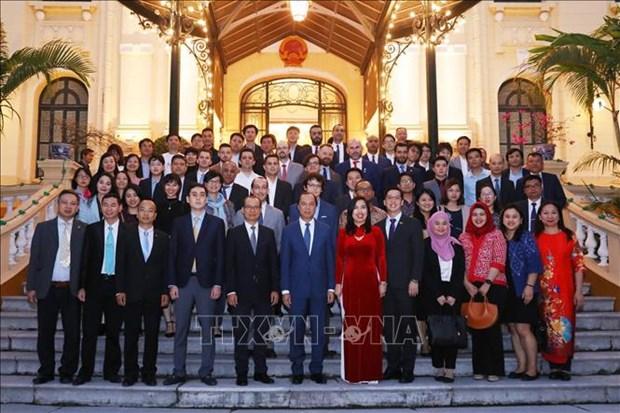 越南外交部举行2020年新年外国驻越代表机构文化新闻随员和国际新闻机构助理和记者见面会 hinh anh 2