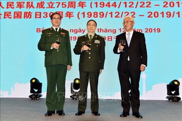 越南人民军建军75周年和全民国防日30周年纪念典礼在中国举行 hinh anh 1