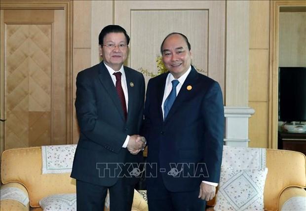 老挝总理通伦·西苏里访问越南:不断增加越老伟大的友谊 hinh anh 1