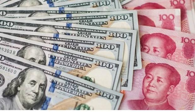 1月2日美元对越盾汇率中间价小幅下降 人民币汇率上升 hinh anh 1
