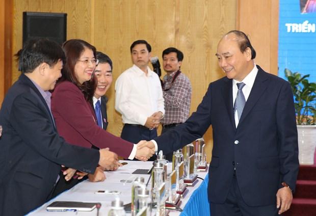 越南政府总理阮春福:促进机制体制建设 构建新经济模式 hinh anh 1