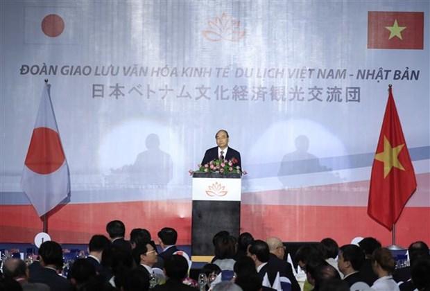 越南政府总理与日本自由民主党秘书长出席越日文化交流晚会 hinh anh 2