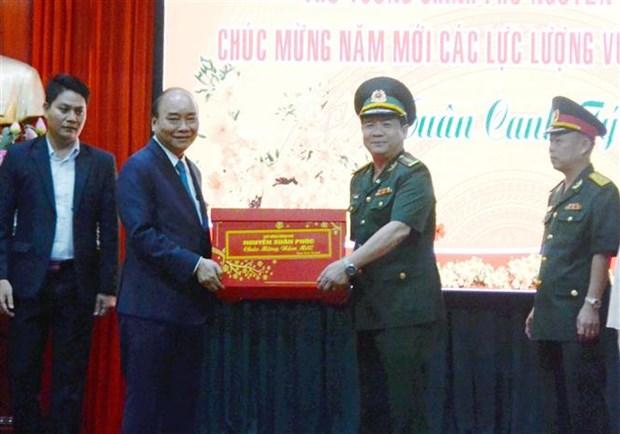 政府总理阮春福向岘港市部分单位拜年 hinh anh 1