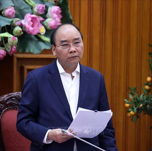 政府总理阮春福:政府愿为保护人民的生命和健康承担经济损失 hinh anh 1