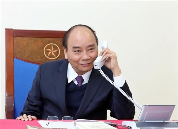 阮春福就东盟各国加强合作应对新冠肺炎疫情与印尼总统佐科通电话 hinh anh 1