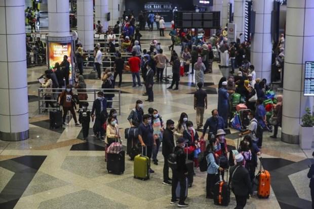 马来西亚扩大中国访客入境限制 hinh anh 1