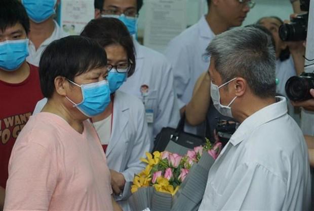 新冠肺炎疫情:在越南确诊患有新冠肺炎的第二名中国人治愈出院 hinh anh 2