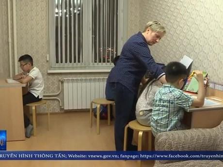 在俄越南学生的第二位母亲 hinh anh 1