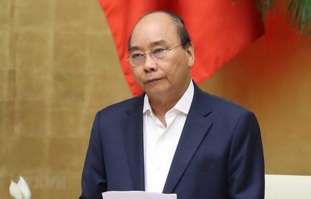 越南政府总理阮春福:继续加大新冠肺炎疫情防控力度 hinh anh 1